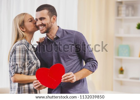 Girlfriend Kisses Boyfriend with Heart Symbol. Romantic Relationship between People Concept. Date on Saint Valentine's Day. Idyll of Young Couple. Love Concept. Romantic Date Concept. #1132039850