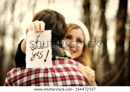 stock-photo-girlfriend-saying-yes-to-a-marry-proposal-166472327.jpg