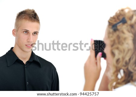 Girlfriend taking picture of her  boyfriend