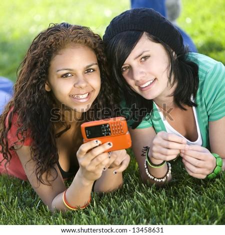Girlfriends share a cell phone
