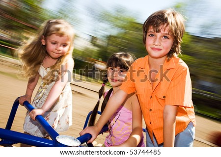 Girls And Boy On Carousel Stock Photo 53744485 : Shutterstock