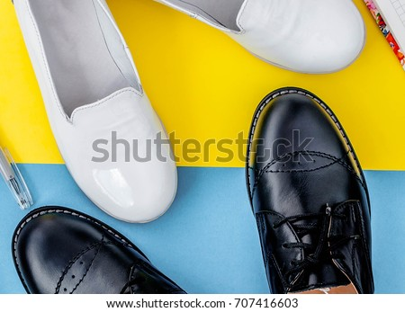 0ff661b139aa Girls and boys have white and black shoes on a yellow-blue background.  Leather