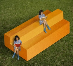 Girls are sitting on the impossible timber.