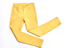 Girls beautiful yellow skinny trousers. Modern pockets yellow trousers for teenagers isolated on white background. Youth summer fashion apparel.