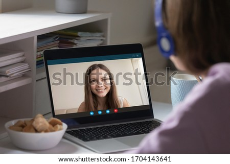 Girls best friends chatting using video conference app and laptop. Concept of distant communication, internet connection pc webcam users. Students e-learning, tutor and learner study remotely concept