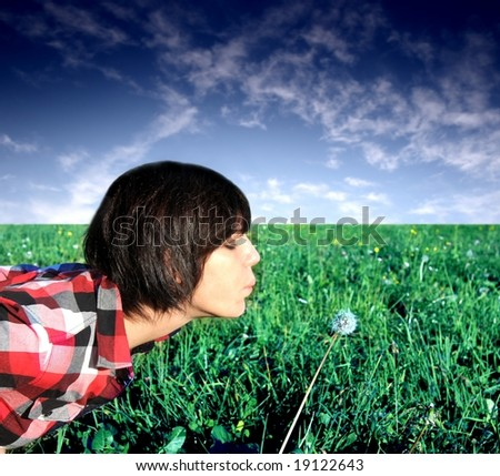 Girls blow the dandelion blossom