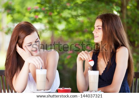 Girls chatting in open terrace on lovely sunny day