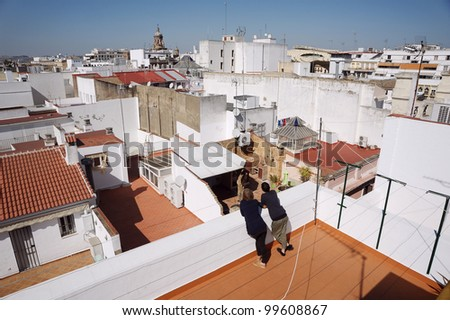 girls chilling on the roof, Spain, Seville.