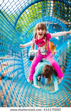 Girls creep in a net tunnel #616170080