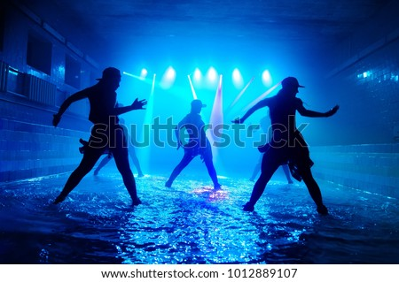 Girls dancing on the water with beautiful light. #1012889107
