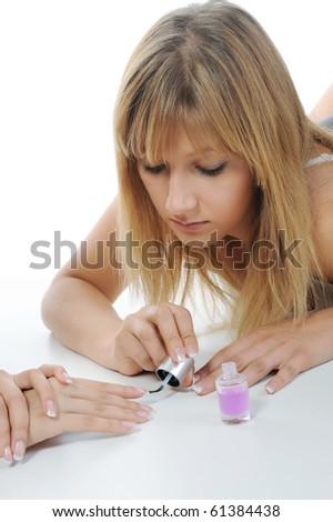 Girls do manicure. Isolated on white background #61384438