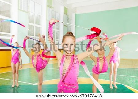 Girls doing rhythmic gymnastics with art ribbon