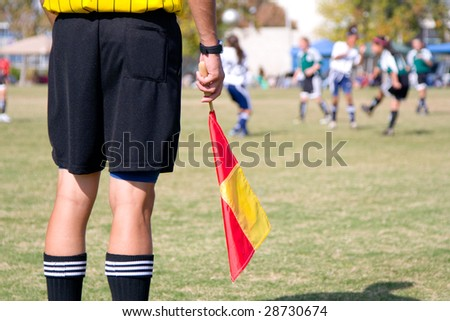 Girls' football soccer referee watching over a game