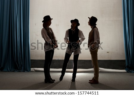 girls gangsters gathered in theater on rehearsal