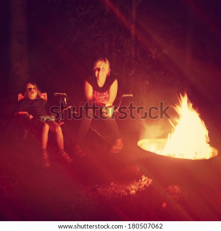 Girls having a campfire in night - Instagram effect