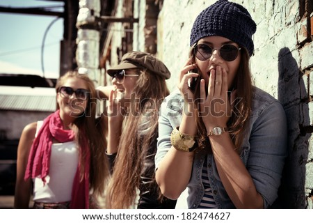 Girls having fun together outdoors and calling smart phone, lifestyle. Instagram effect. ストックフォト ©