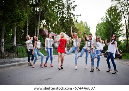 Girls having fun while posing outside in the park on the bachelorette party. #674446837