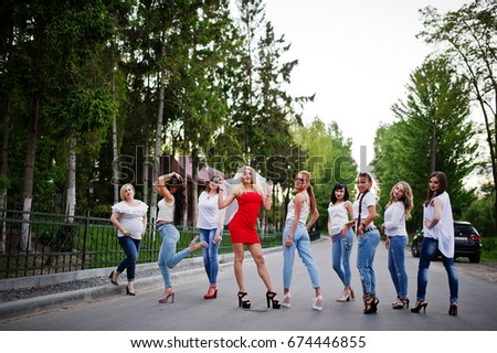 Girls having fun while posing outside in the park on the bachelorette party. #674446855