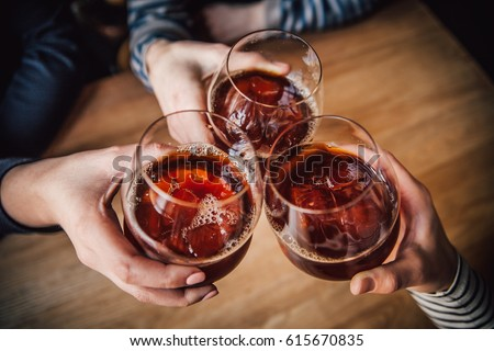 Girls having good time,cheering and drinking alcoholic cocktails, enjoying friendship together in coffee shop, close up view on hands   #615670835