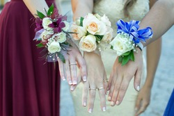 Girls heading to prom with their flower corsages