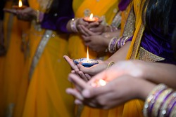 Girls holding candles for henna party