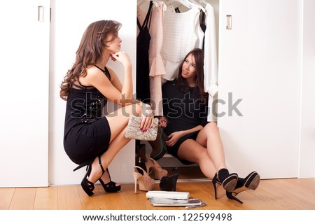 Girls in front of a wardrobe closet