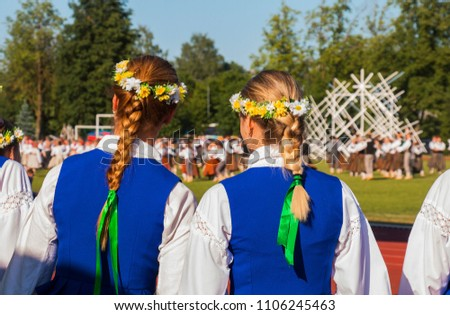 girls in national costumes at a concert