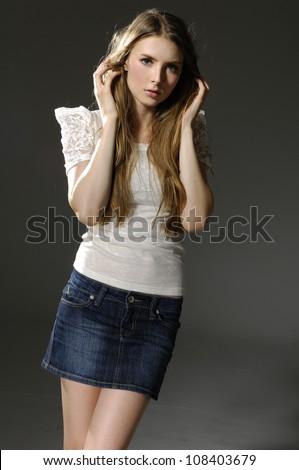 Girls in short skirt and a dark blouse posing