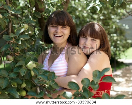 Girls in the apple orchard