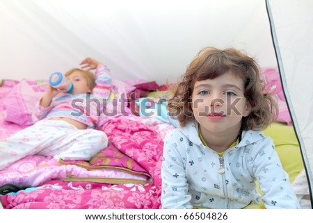girls inside camping tent sisters happy two little friends