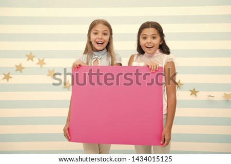 Girls kids hold advertisement poster copy space. Children hold advertising banner. Happy children with blank paper for advertisement. Advertisement concept. Your advertisement in good hands. #1434015125