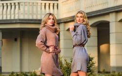 Girls look very nice in fall outfits. Emphasize waist with strap belt. Knitwear concept. Cashmere woolen sweaters. Warm oversized sweaters. Women wear sweaters. Elongated sweatshirts tunics or dress.