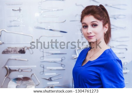 girls nurse are studying surgical instruments. Medical education #1304761273