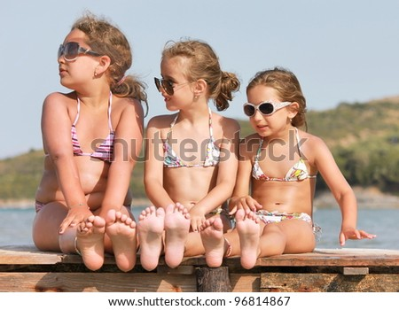Girls on the wooden pier