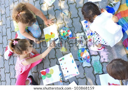 Girls painting outside