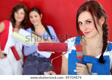 girls painting their new apartment