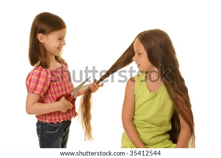 Girls play a hairdressing salon