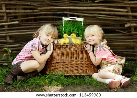 Girls play with duck