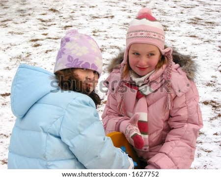 Girls playing at the playground at winter time