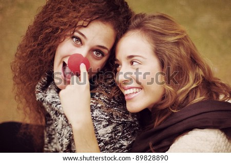Girls playing with clown nose