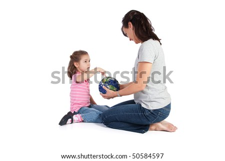 Girls pointing at globe and asking her mother questions about the world. Isolated on white. - stock photo