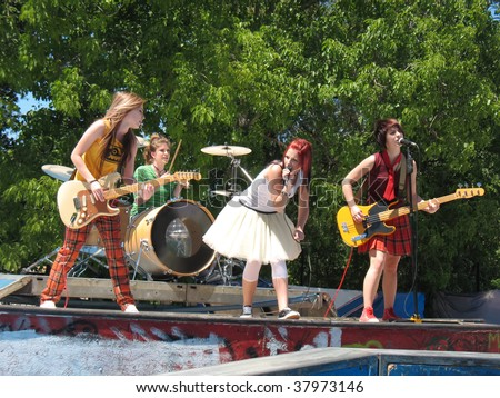 girls rock band on stage - stock photo