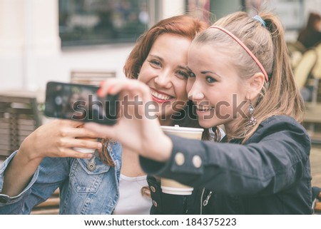 Girls Taking Pictures with Mobile Phone