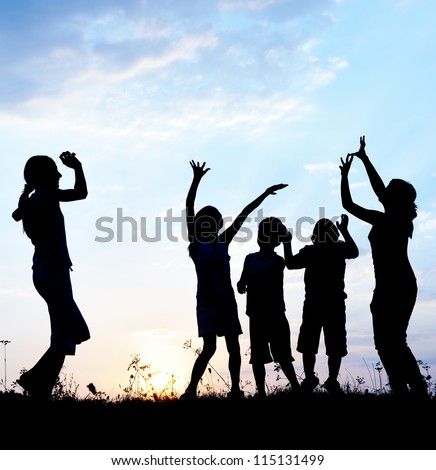 Girls teenagers and little boys dancing on field