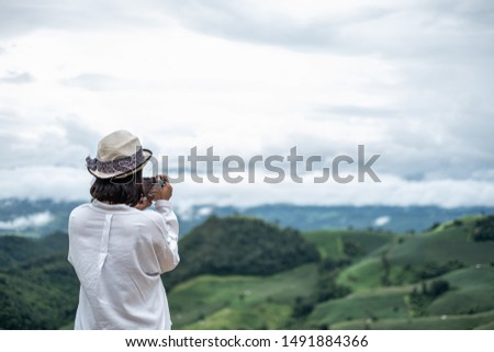 Girls touring and taking pictures of rain forests in northern Thailand