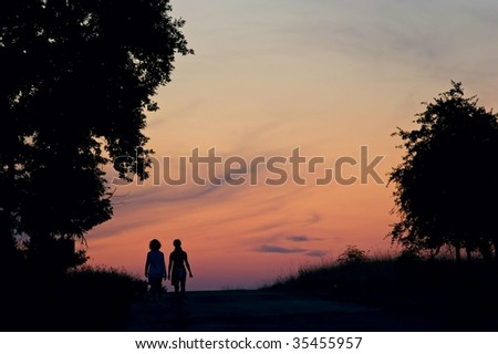Girls walking in the sunset