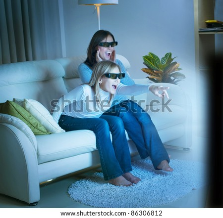 Girls watching 3d film on TV