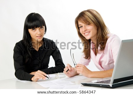 girls with documents and laptop