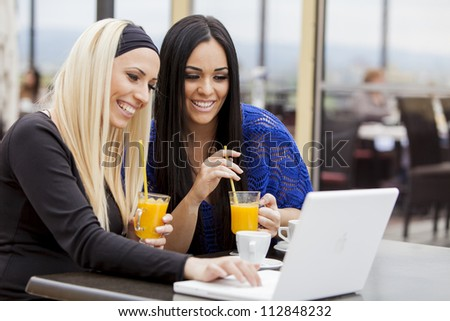Girls with laptop - stock photo