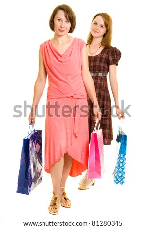 Girls with shopping on white background.